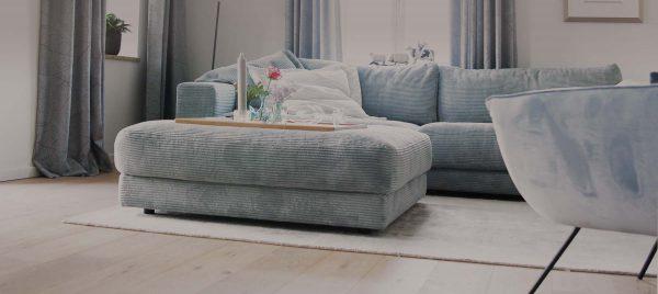 Boarding House Ansicht des gemütlichen Wohnzimmer - In behaglicher Atmosphäre mit exclusiver Ausstattung nach der Arbeit entspannen bei Boarding Select am Kattenstrother Weg in Gütersloh.
