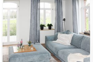 Wohnen mit Blick ins Grüne - Ansicht des gemütlichen Wohnzimmer